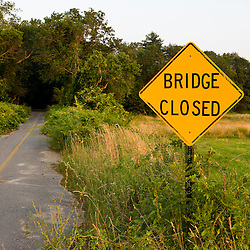 A road unused, due to an abandoned bridge over the Taunton RIver in Bridgewater, Massachusetts.