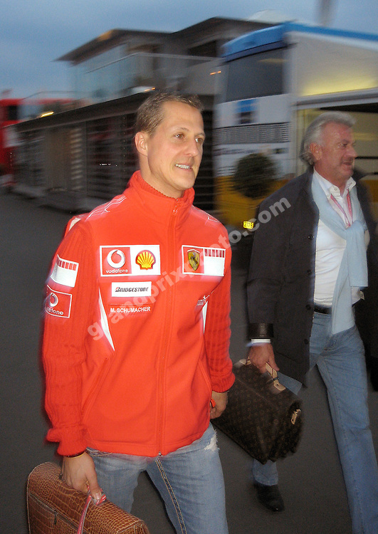 Ferrari driver Michael Schumacher and his manager Willy Weber leaves the paddock after practice for the 2006 European Grand Prix at the Nurburgring. Photo: Grand Prix Photo