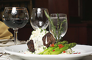 KEVIN BARTRAM/The Daily News.Herb crusted filet of beef with a gorgonzola suace accompanied by roasted garlic mashed potatoes and asparagus spears prepared by San Luis Resort executive chef Sean Moore will be featured at the Junior League Pennies from Heaven evening.