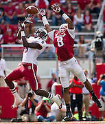 Oct 12, 2013; Fayetteville, AR, USA; Arkansas Razorback cornerback Tevin Mitchel (8) breaks up a pass intended for South Carolina Gamecock wide receiver Shamier Jeffery (8) during the second half of a game at Donald W. Reynolds Razorback Stadium. South Carolina defeated Arkansas 52-7. Mandatory Credit: Beth Hall-USA TODAY Sports