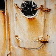 Rusty door on an aging fishing trawler, Gloucester, MA