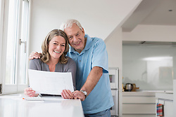 Smiling couple looking at construction plan