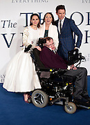 "Dec 9, 2014 - ""The Theory Of Everything"" - UK Premiere - Red Carpet Arrivals at Odeon,  Leicester Square, London<br /> <br /> Pictured:  Professor Stephen Hawking; Eddie Redmayne; Felicity Jones<br /> ©Exclusivepix Media"