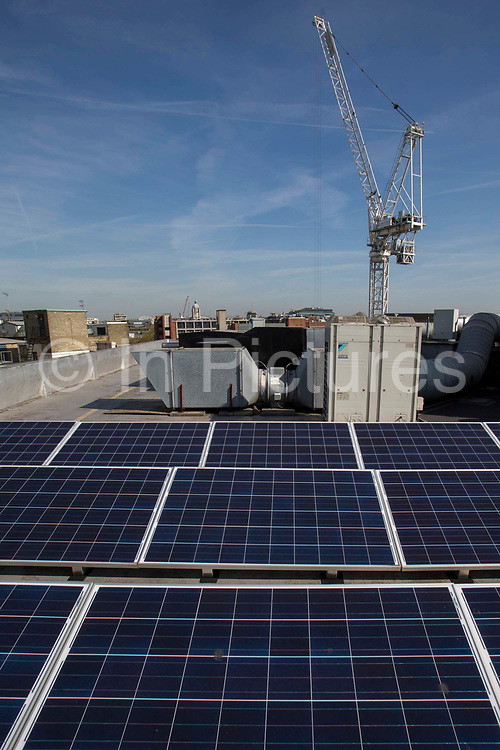 Solar panels on the roof of one of he London School of Economics and Political Science LSE buidlings. Westminster, Central London. One of the leading social science universities in the world with students attending from over 155 different nations.