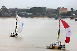 2008 Monsoon Cup.Magnus Holmberg leading Ben Ainslie in the rain (Thursday  5th December 2008). .