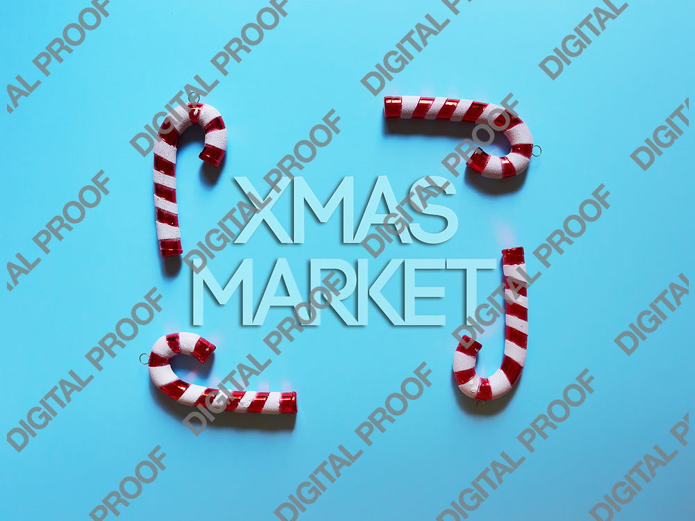 Christmas candy cane drums  at studio above view over a light blue background isolated flatlay with xmas market text