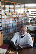 A researcher in the library of the French Institute, Pondicherry, India. Pondicherry now Puducherry is a Union Territory of India and was a French territory until 1954 legally on 16 August 1962. The French Quarter of the town retains a strong French influence in terms of architecture and culture.