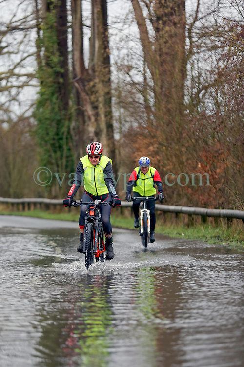 04 February 2021. Le Blanc Pignon, Pas de Calais, France.<br /> Cyclists tentatively make their way through record flooding from the Canche river which inundated roads surrounding the town of Le Blanc Pignon in Pas de Calais in north western France.<br /> Photo©; Charlie Varley/varleypix.com<br /> All rights managed.