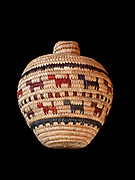 Yupik grass and seal gut basket decorated with dogs woven by Julia Stone of Alaska. (Please note:  Licensing of this photo requires a license and additional fee to be paid to the basket's creator, Julia Stone)