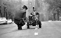 An army technical officer, ATO, sets up Goliath, the army's bomb disposal robot to investigate a suspect vehicle in Eglantine Avenue, Belfast, during the Troubles in N Ireland. Goliath was developed by a joint military/civilian group of scientists and technicians working in secrecy and a high degree of autonomy. In military circles it was known as the Mk3 Wheelbarrow.   197305110334b.<br /> <br /> Copyright Image from Victor Patterson, 54 Dorchester Park, Belfast, UK, BT9 6RJ<br /> <br /> t1: +44 28 9066 1296 (from Rep of Ireland 048 9066 1296)<br /> t2: +44 28 9002 2446 (from Rep of Ireland 048 9002 2446)<br /> m: +44 7802 353836<br /> <br /> e1: victorpatterson@me.com<br /> e2: victorpatterson@gmail.com<br /> <br /> The use of my copyright images is subject to my Terms & Conditions.<br /> <br /> It is IMPORTANT that you familiarise yourself with them. They are available on my website at www.victorpatterson.com.<br /> <br /> None of my copyright images may be used on a website unless they are visibly watermarked, i.e. © Victor Patterson within the body of the visible image. Metadata denoting my copyright must NOT be deleted. <br /> <br /> Web use (maximum size - 400 kb) is extra at currently recommended NUJ rates.