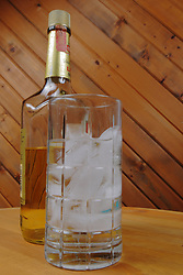 "Food and Drink industry: alcohol, hard liquor chilled ""on the rocks"" or over ice in a clear glass tumbler."