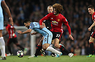 Marouane Fellaini of Manchester United is booked for a tackle on Sergio Aguero of Manchester City during the English Premier League match at The Etihad Stadium, Manchester. Picture date: April 27th, 2016. Photo credit should read: Lynne Cameron/Sportimage