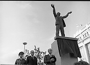 Jim Larkin Statue. O'Connell Street Dublin.   (M77)..1979..15.06.1979..06.15.1979..15th June 1979..Today saw the unveiling of a statue in memory of James (Big Jim) Larkin. Larkin was a trade union activist who was a thorn in the side of many employers who refused to allow workers join unions. A dispute with The Dublin United Tramway Company  escalated into what is now known as the great lock out. Employers banded together and wanted workers to sign a pledge stating that they would not join Larkin's union the Irish Transport And General workers Union (ITGWU). The lock out lasted seven months. During this time Larkin was nited for his rhetoric in standing up for the poor and oppressed within Irish Society...Jim Larkin: Born Jan 21 1876 .Died Jan 30 1947...President of Ireland Dr Patrick Hillery is pictured as the Irish National Anthem is played at the unveiling.