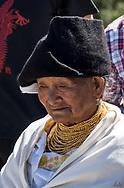 Casual portrait of an Elder Kichwa woman in a black headress