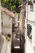 Narrow alleyway named Candil in the Moorish housing district of Albaicin, Granada, Spain