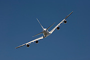 Malaysian Airlines Airbus A380 performs in blue skies during Britain's Farnborough Air Show.
