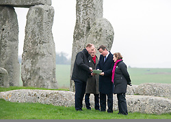 © Licensed to London News Pictures. 01/12/2014. Wiltshire, UK. (L-R) Andrew Page-Dove, Regional Director of the Highways Agency, Simon Thurley (red scarf) Director of English Heritage, David Cameron and Dame Helen Ghosh, Director-General of the National Trust.  British Prime Minister David Cameron visits Stonehenge today 1st December 2014. A tunnel passing Stonehenge is among dozens of new road schemes announced by the government, as part of £15bn of improvements to England's roads. Photo credit : Stephen Simpson/LNP