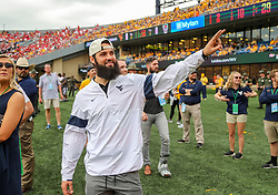 Sep 14, 2019; Morgantown, WV, USA; Former West Virginia Mountaineers quarterback and current Carolina Panthers quarterback Will Grier waves to the crowd during the first quarter against the North Carolina State Wolfpack at Mountaineer Field at Milan Puskar Stadium. Mandatory Credit: Ben Queen-USA TODAY Sports