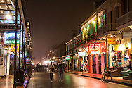 January 9, 2013, New Orleans LA, Tourists on Bourbon Street on a foggy night in the French Quarter.