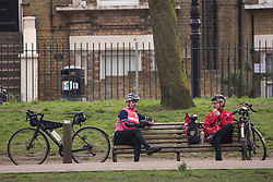 © Licensed to London News Pictures. 08/03/2021. London, UK. Members of the public enjoy Monday afternoon in Victoria Park, east London. Since today two members of different households are allowed to meet up outside. Photo credit: Marcin Nowak/LNP