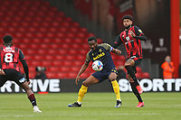 Football - 2020 / 2021 Sky Bet Championship - AFC Bournemouth vs. Stoke City - The Vitality Stadium<br /> <br /> John Obi Mikel of Stoke City and Bournemouth's Philip Billing in action during the Championship match at the Vitality Stadium (Dean Court) Bournemouth <br /> <br /> COLORSPORT/SHAUN BOGGUST