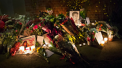 © Licensed to London News Pictures. 26/12/2016. Goring-, UK. Tributes to George Michael are placed at the front door of his house in Goring. Pop superstar George Michael died on Christmas day at his Oxfordshire home on the River Thames aged 53. Photo credit: Peter Macdiarmid/LNP