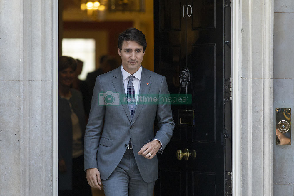 April 18, 2018 - London, London, UK - London, UK. Prime Minister of Canada Justin Trudeau leaves 10 Downing Street after meeting with Prime Minister Theresa May. (Credit Image: © Rob Pinney/London News Pictures via ZUMA Wire)