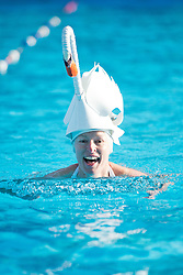 ©  London News Pictures. 26/01/2013. London, UK. Kate Webb wearing a swan hat while competing in the Cold Water Swimming Championships at Tooting Bec Lido in South London on January 26, 2013. The biannual event sees some competitors dress in costume. Photo credit: Ben Cawthra/LNP