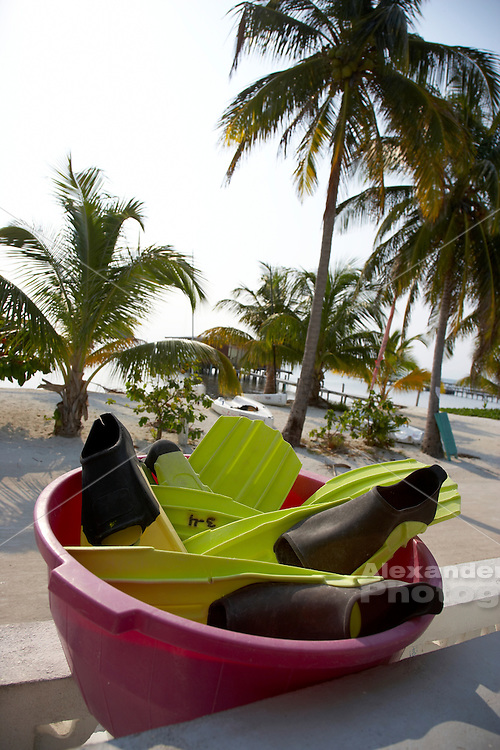 Belize, Central America - Basin full of swim fins outside a dive center on Caye Caulker