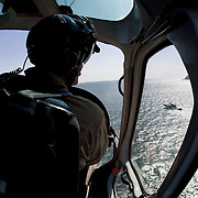 """Adam Polak, Customs and Border Protection agent with the Air and Marine division, patrols the shoreline along the U.S/Mexico border in San Diego, California. For more images, search for """"immigration by air and sea"""". Please contact Todd Bigelow directly with your licensing requests. PLEASE CONTACT TODD BIGELOW DIRECTLY WITH YOUR LICENSING REQUEST. THANK YOU!"""