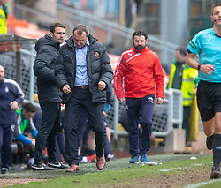 Dundee United's manager Csaba Laszlo celebrates at teh end of the game as Falkirk's manager Paul Hartley approaches. Dundee United 1 v 0 Falkirk, Scottish Championship played 14/4/2018 at Dundee United's stadium Tannadice Park.