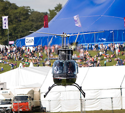 Paul Harknoll from Orbital goes up in a helicopter passing over the Clash Arena..Rockness, Saturday 13th June 2009..Pic © Michael Schofield. All Rights Reserved.
