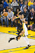 Golden State Warriors guard Shaun Livingston (34) defends Cleveland Cavaliers guard Jordan Clarkson (8) during Game 1 of the NBA Finals at Oracle Arena in Oakland, Calif., on May 31, 2018. (Stan Olszewski/Special to S.F. Examiner)