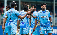 ANTWERP -    Indian Sardar Singh (C)  (l) scored  2-0 during  the match India v Poland (3-0) . right Devindar Walmiki.  WSP COPYRIGHT KOEN SUYK