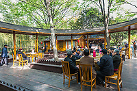 Shanghai, China - April 7, 2013: people sitting drinking discussing in gucheng park at the city of Shanghai in China on april 7th, 2013