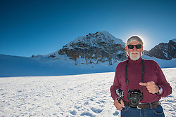 I call this one Saint Ed, because I framed his head with the setting sun on the upper base of Mount Denali, Alaska.
