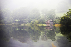 September 14, 2016 - Pooley Bridge, Cumbria, UK - Pooley Bridge UK. Picture shows a boat house on the banks of Ullswater Lake in the morning mist near Pooley Bridge this morning. After last nights thunderstorms in the north of England Cumbria woke to a calm but misty morning. (Credit Image: © Andrew Mccaren/London News Pictures via ZUMA Wire)