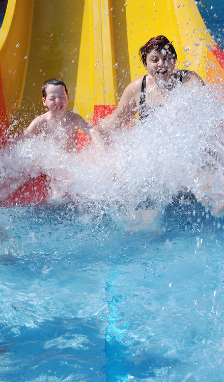 Mother and son aged 5 on a water slide Model Release Available