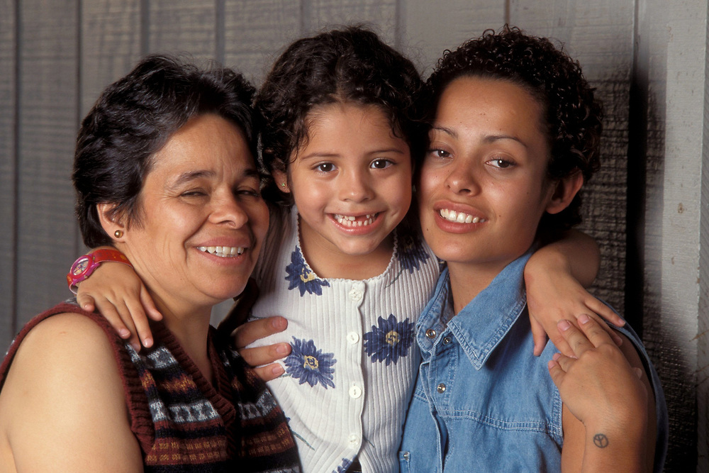 Three generations (41, 20, and 4 years old) of a Hispanic family at home in South Texas.  Model Release.<br /> ©Bob Daemmrich