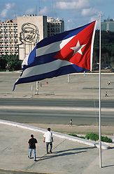 View of Revolution Square; Havana; Cuba; with Cuban flag and portrait of Che Guevara on the MINIT building,