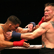 TAMPA, FL - JUNE 22: Joe Riggs (R) and Walber Barros exchange blows during the Bare Knuckle Fighting Championships at Florida State Fairgrounds Entertainment Hall on June 22, 2019 in Tampa, Florida. (Photo by Alex Menendez/Getty Images) *** Local Caption *** Joe Riggs; Walber Barros