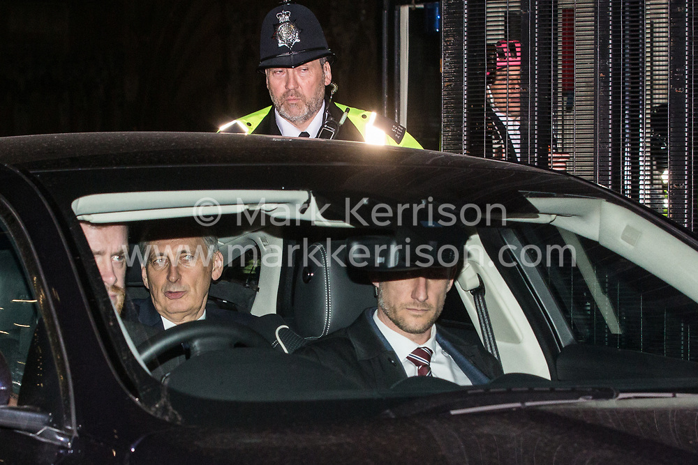 London, UK. 20th March, 2019. Philip Hammond MP, Chancellor of the Exchequer, leaves the House of Commons on the evening that Prime Minister Theresa May was meeting Opposition leaders to discuss extending Article 50 before travelling to Brussels tomorrow for an EU summit.
