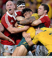 22 June 2013; Digby Ioane, Australia, is tackled by Paul O'Connell, left, and George North, British & Irish Lions. British & Irish Lions Tour 2013, 1st Test, Australia v British & Irish Lions, Suncorp Stadium, Brisbane, Queensland, Australia. Picture credit: Stephen McCarthy / SPORTSFILE