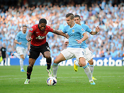 Manchester City's Matija Nastasic challenges Manchester United's Luis Antonio Valencia for the ball - Photo mandatory by-line: Dougie Allward/JMP - Tel: Mobile: 07966 386802 22/09/2013 - SPORT - FOOTBALL - City of Manchester Stadium - Manchester - Manchester City V Manchester United - Barclays Premier League