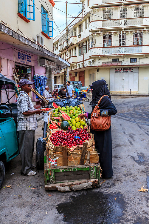 A fruit seller in Old Town, Mombasa, Kenya.