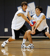 Heritage High's Austin Roach, right, returns the ball while Clay Combs watches during a match against Freedom High on Tuesday, May 8, 2012 at Heritage High School.  (Photo by Kevin Bartram)