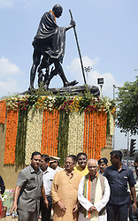 October 2, 2018 - Kolkata, West Bengal, India - West Bengal Governor Kehsari Nath Tripathi (second right) pays tribute Mahatma Gandhi to commemorate his 149th birth anniversary. (Credit Image: © Saikat Paul/Pacific Press via ZUMA Wire)