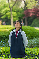 Shanghai, China - April 7, 2013: one woman exercising meditation in fuxing park at the city of Shanghai in China on april 7th, 2013