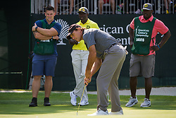 July 15, 2018 - Stateline, Nevada, U.S - Heisman Trophy winner and former NFL quarterback, DOUG FLUTIE, putts on the 17th green .at the 29th annual American Century Championship at the Edgewood Tahoe Golf Course at Lake Tahoe, Stateline, Nevada, on Sunday, July 15, 2018. Flutie's caddy, former NFL running back, TERRELL DAVIS, and Davis' caddy look on. (Credit Image: © Tracy Barbutes via ZUMA Wire)