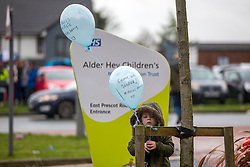 © Licensed to London News Pictures. 24/04/2018. Liverpool UK. Picture shows a little boy place a balloon outside Alder Hey Hospital with a message to Alfie Evans. 23 month old Alfie Evans life support has been withdrawn at Alder hey hospital in Liverpool but it is reported that he has been breathing unaided for 9 hours. Alfie has been living in a coma for the past year after being struck down with a mystery illness his parents Kate James & Tom Evans have been fighting legal cases t keep him alive & move him abroad for medical treatment. Photo credit: Andrew McCaren/LNP